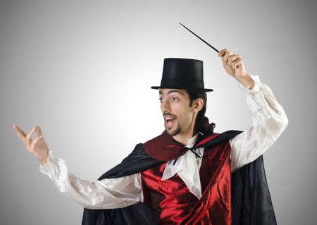 abracadabra: Magician doing tricks on white Stock Photo