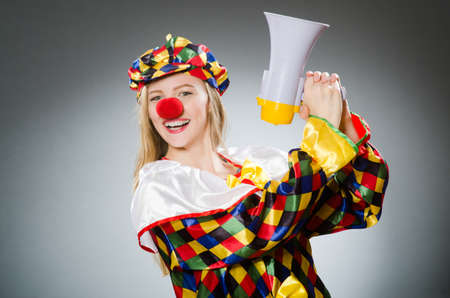 buffoon: Clown with loudspeaker isolated on white Stock Photo