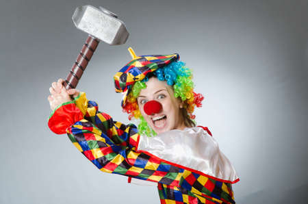 pierrot: Clown with hammer in funny concept