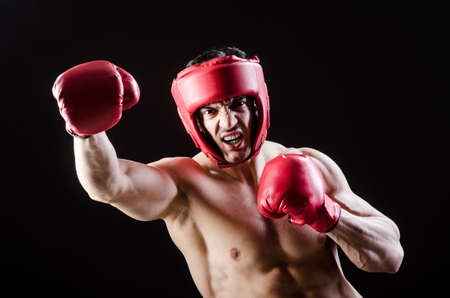 muscle boy: Muscular man in boxing concept