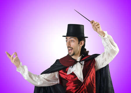 magic hat: Magician doing tricks on white Stock Photo