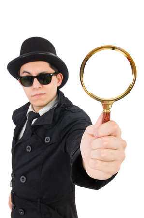 bloodhound: Young detective in black coat holding magnifying glass isolated on white