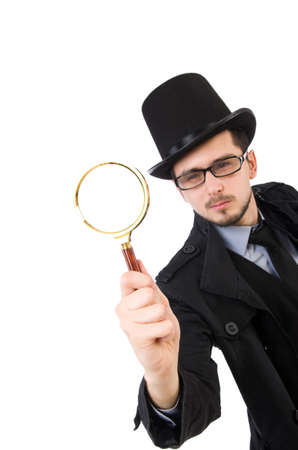 detective agency: Young detective with magnifying glass isolated on white