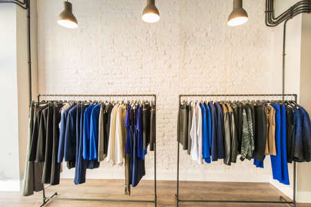 clothing rack: Interior of fashion clothing shop Stock Photo