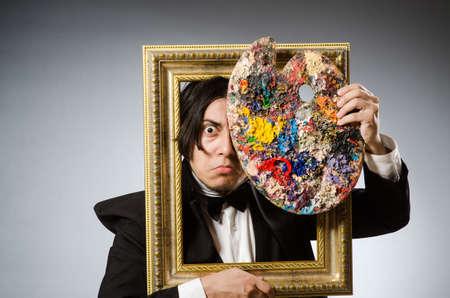 creativity artist: Funny artist in dark studio Stock Photo