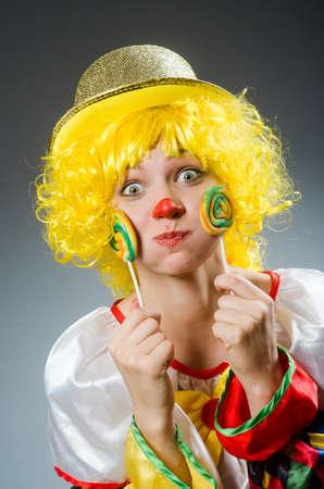 lolli: Clown in funny concept on dark background