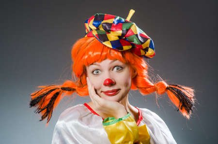 party hat: Clown in funny concept on dark background