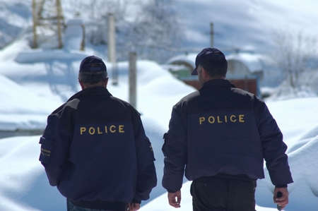 detain: Police patrol in winter