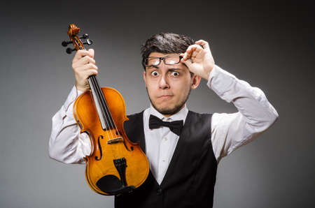 solo violinist: Funny violin player with fiddle Stock Photo