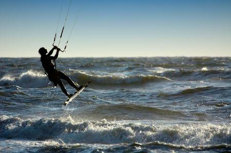 A kitesurfer going up