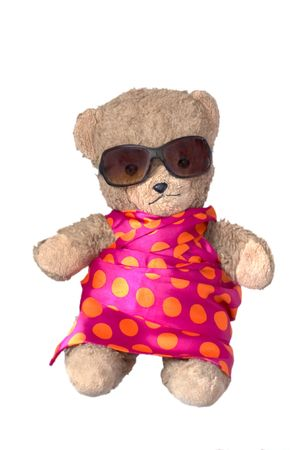 photo of a teddybear in colorful dress wit sunglasses photo