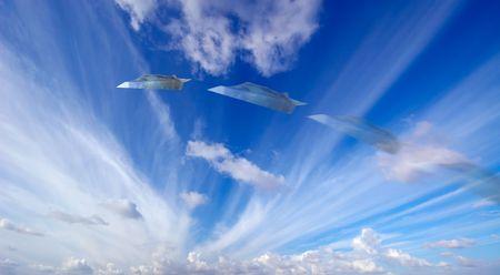 Moneyplane against a blue sky photo