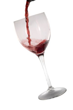 inebriated: Red wine poured into glass isolated on white Stock Photo
