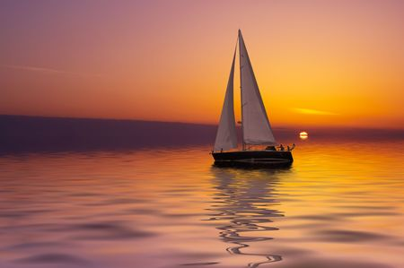 Sailboat against a beautiful sunset Stock Photo - 440014