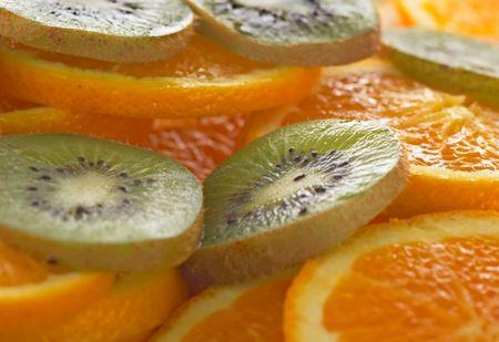 Kiwi and oranges background Stock Photo - 448096