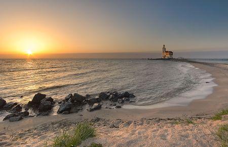 A beautiful beach and lighthouse at sunrise Stock Photo - 458077