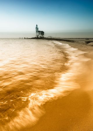 A beautiful beach and lighthouse photo