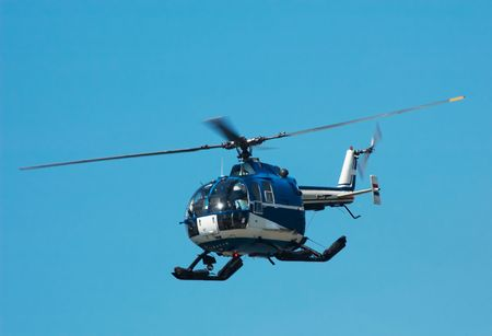 helicopter pad: Photo of a helicopter against a blue sky