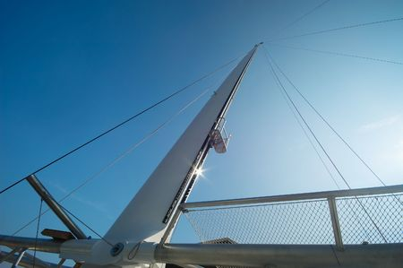 abstract photo of a sailboat against a blue sky photo