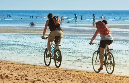 mountain biking on the beach in summer Stock Photo - 475365