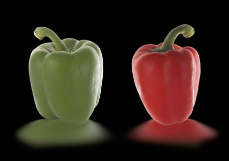 red and green pepper isolated on black photo