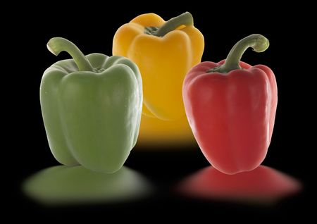 peppers in different colors isolated on black photo