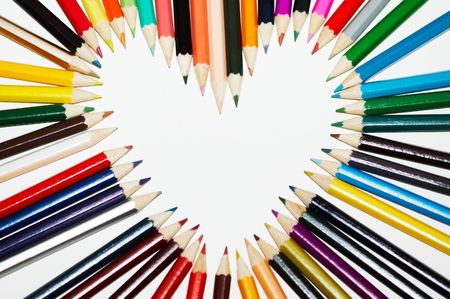 Colored pencils in a heart shape photo
