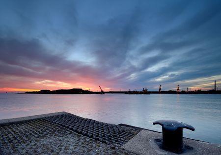 A harbor in the netherlands during sunset photo