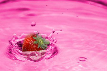 A strawberry drops into lemonade Stock Photo - 488850