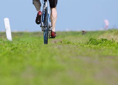 abstract photo of a man on a bicycle photo taken from a very low angle Stock Photo - 488824
