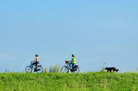 cycling on a summerday with a dog running behind Stock Photo - 488798