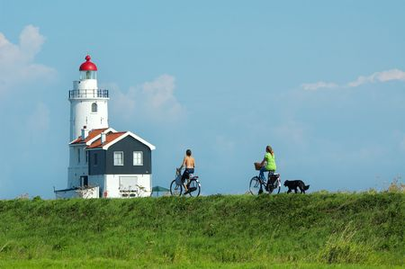 cycling towards the lighthouse on a summerday Stock Photo - 488806