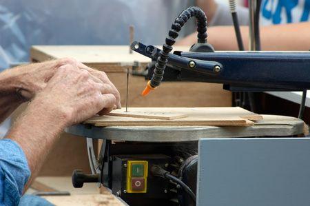 sawing: man sawing wood