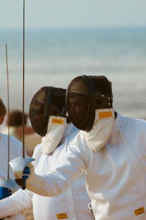 pentathlon: Fencing on the beach Stock Photo