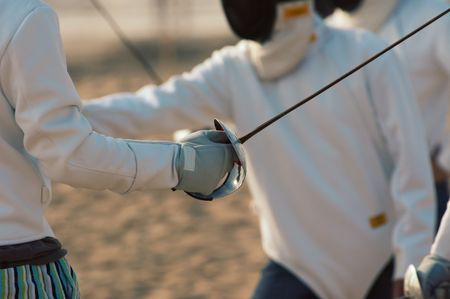 rapier: Fencing on the beach Stock Photo