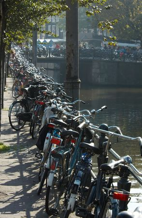 along: bicycles in amsterdam along the canal Stock Photo