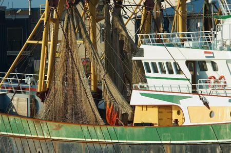fishing ships in the harbor photo