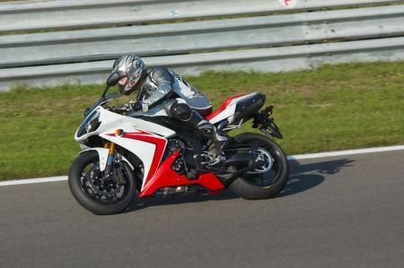 Motorbike racing in circuit Stock fotó