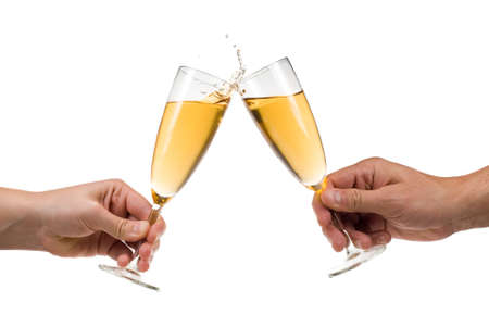 holydays: Man and woman toasting champagne with splash isolated on a white background