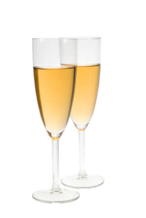 fresh graduate: two glasses filled with champagne isolated on a white background