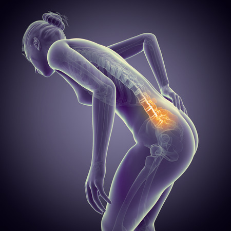 a woman having acute pain in the back Stock Photo