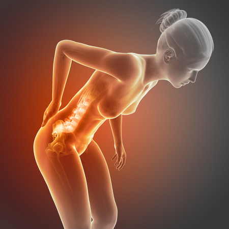 woman back pain: a woman having acute pain in the back Stock Photo