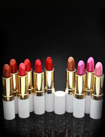 fem: A lot of lipstick over a black background