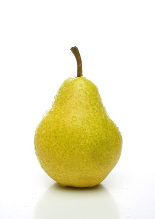 On yellow pear with drops on white background. Look for more fruits and vegetables at my gallery