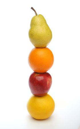 balanced diet: Pear, orange, apple, grapefruit totem for a balanced diet. White background. Look at my gallery for more fresh fruits and vegetables. Stock Photo
