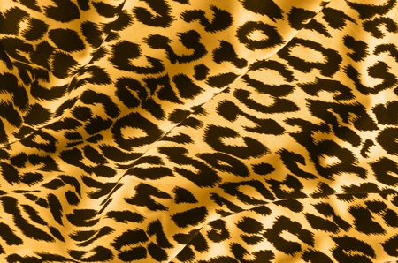 Animal print on fabric. Leopard, tiger.  Look at my gallery for more backgrounds and textures Stock Photo