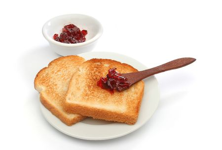 Two toast on a plate with red jam behind. Deliciuos food for breakfast.  Look at my gallery for more meals photo
