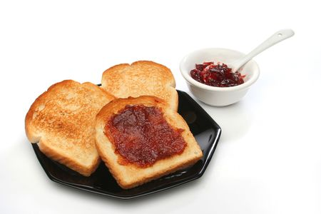 Three toast on a plate with  red jam behind. Deliciuos food for breakfast. White background.  Look at my gallery for more meals photo