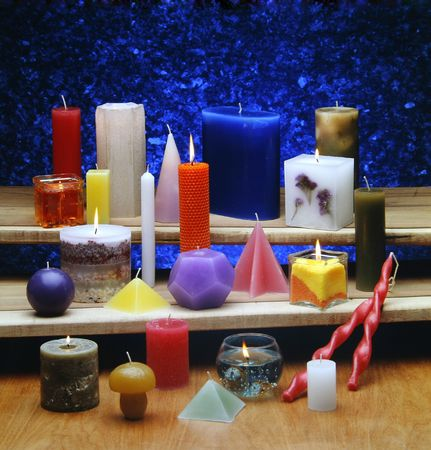 All types of scented candles for aromatherapy and decoration, blue background