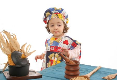 Cute toddler cooking dressed as a chef. More pictures of this  at my gallery Stock Photo - 401642
